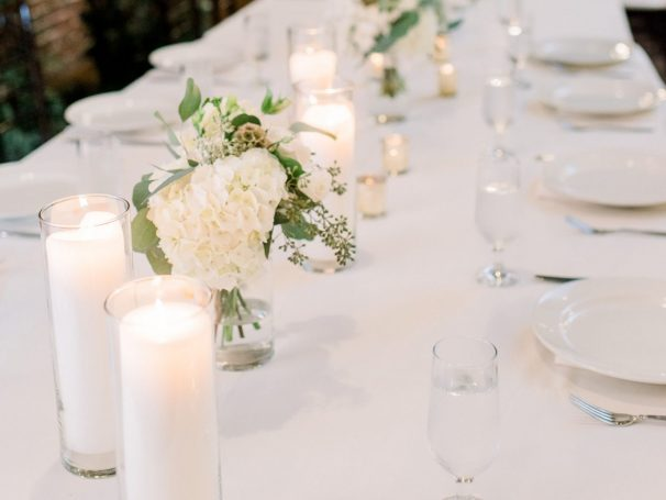 Poured Candles | White Linens & Napkins | Fresh Greenery | China Plates & Silver Flatware